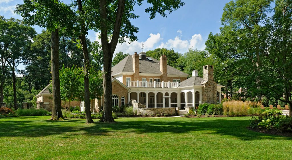 landscape design shows great lawn with porch and loggia in distance