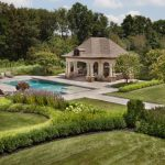 naturally pruned landscaping surrounding pool house