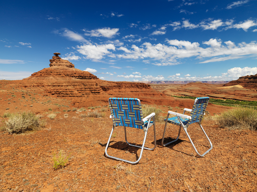 lawn chairs in desert