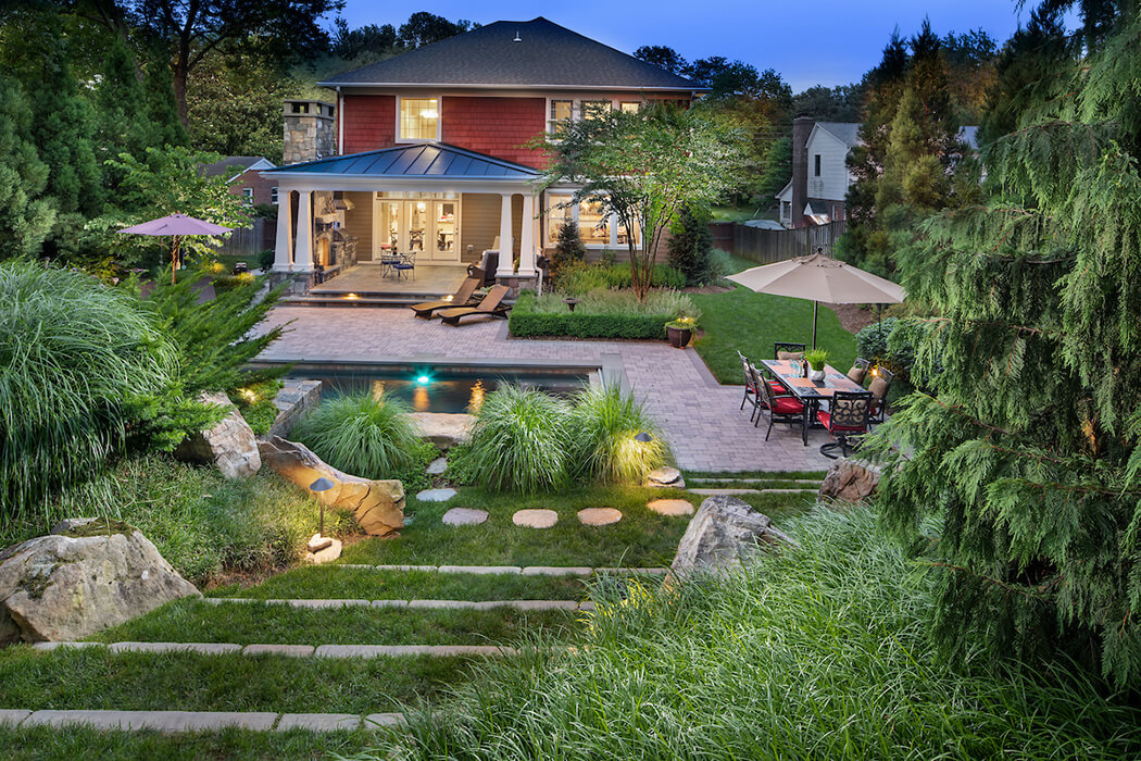 backyard landscaping with pool and patio dining