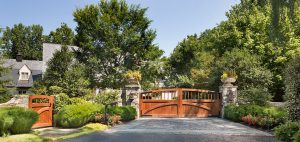front yard landscape with driveway entry gate