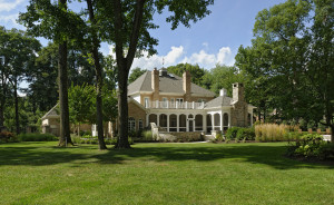 grand formal front lawn presents the home