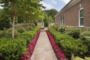 layered landscaping along side yard walkway