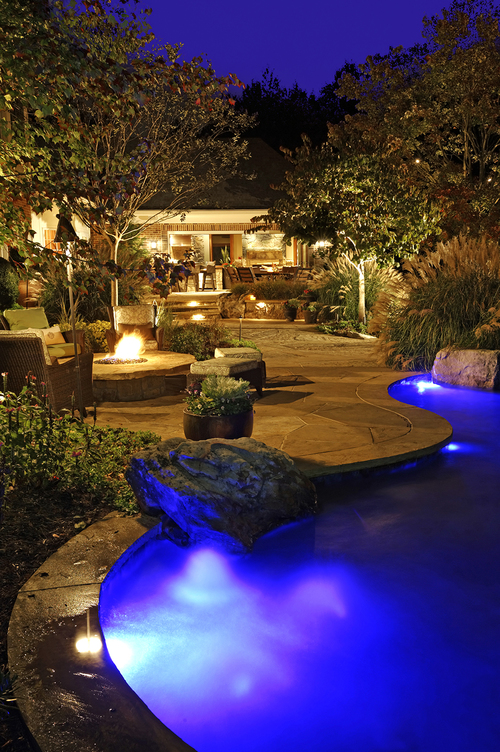 landscape lighting at patio fire pit