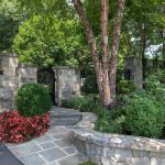 low retaining wall and bluestone walking path