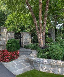 low retaining wall and bluestone walking path