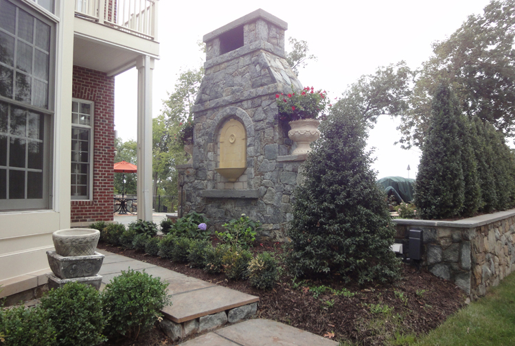 outdoor fireplace with wall mounted fountain