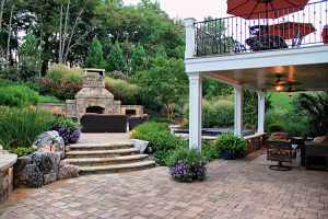 blending hardscape and ascending layers of landscaping