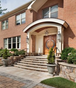 front entry portico bordered by retaining walls