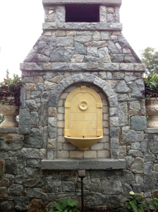 wall mounted fountain and outdoor fireplace