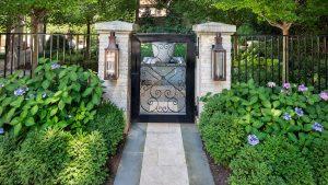 iron garden gate and stone pillars