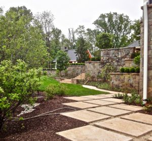 terraced retaining walls support dining patio and biofiltration sinks