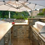 outdoor kitchen on pool patio