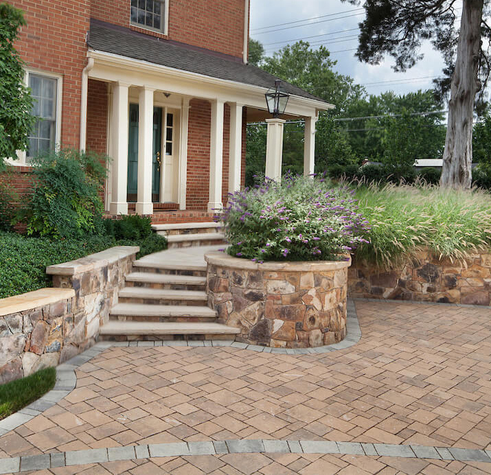 paver driveway and slab stone walkway