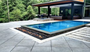 paver pool deck with slab sized square pavers