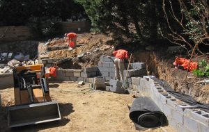 retaining wall block and stone construction