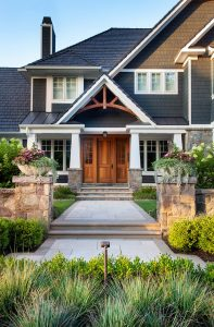symmetrical front yard landscaping with straight walkway