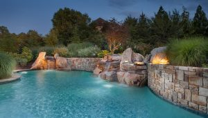 swimming pool with retaining wall and waterfalls