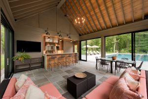 pool house exterior exposed rafters on vaulted ceiling