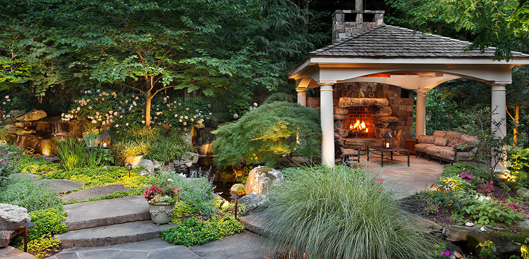 backyard fireplace in secluded pavilion