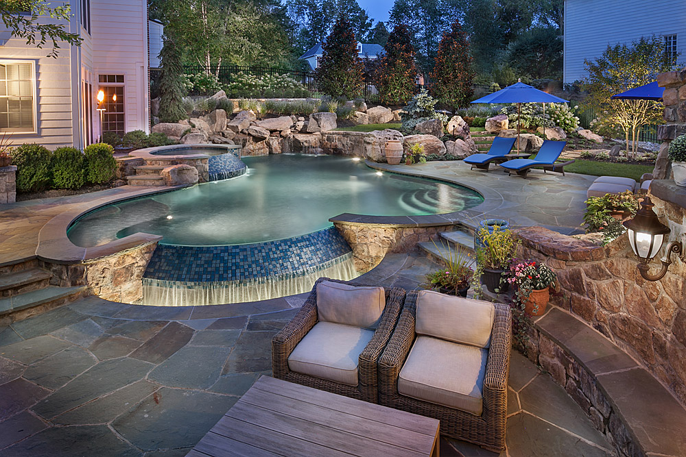 lagoon style pool with zero edge water spillways