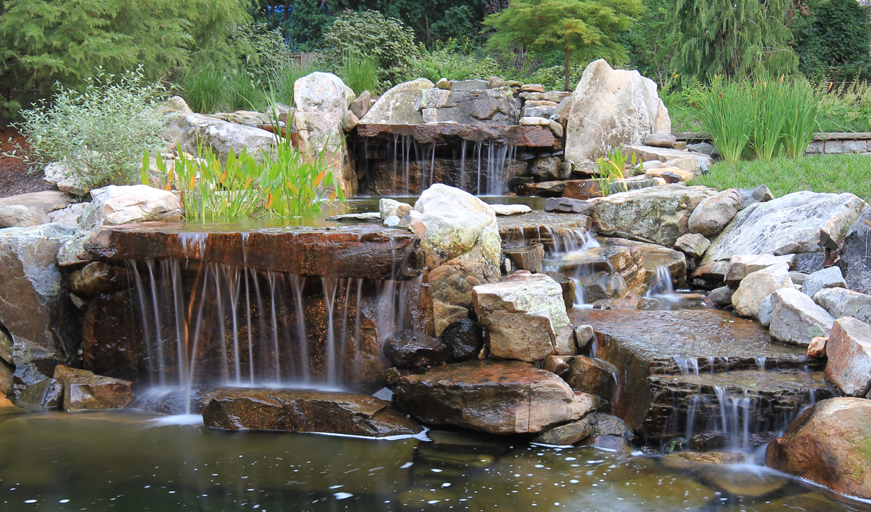 multi cascade waterfalls & koi pond