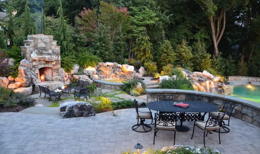 patio-with-outdoor-fireplace-spa-waterfall