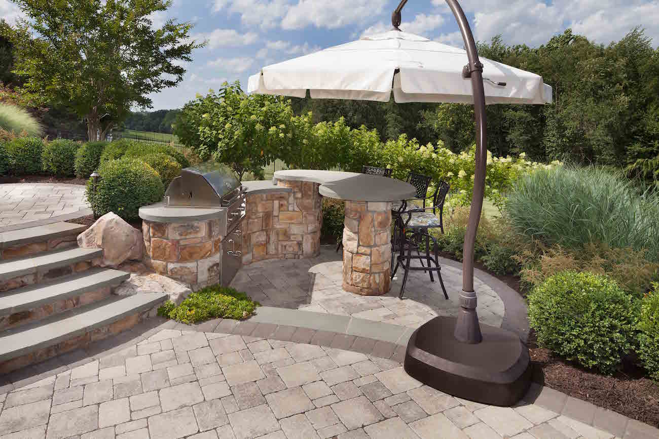 outdoor grill station and raised patio