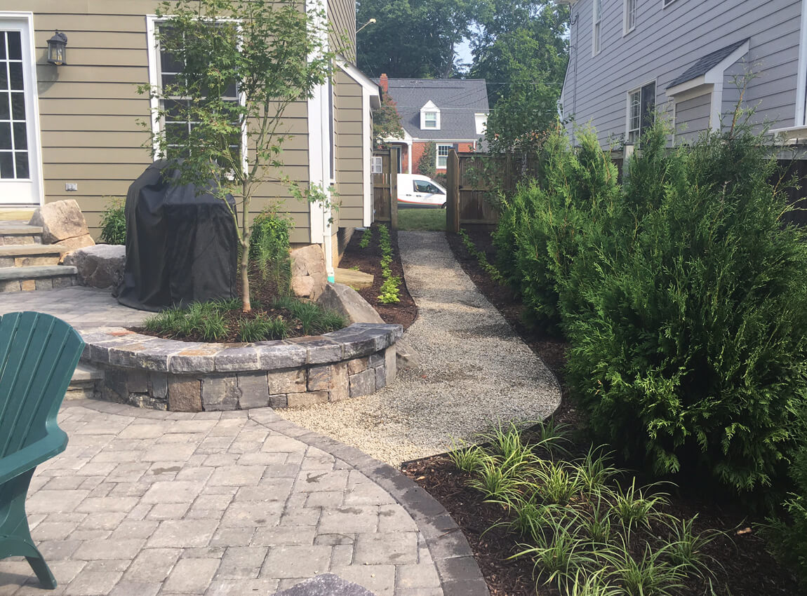 pea gravel path and plantings in side yard