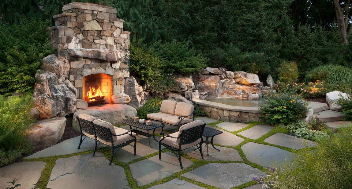 outdoor fireplace with fieldstone and building stone
