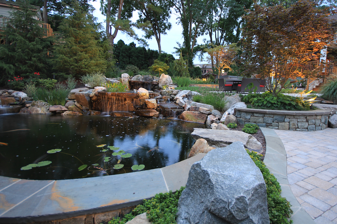 Waterfall koi pond design in vienna virginia surrounds for Patio koi pond
