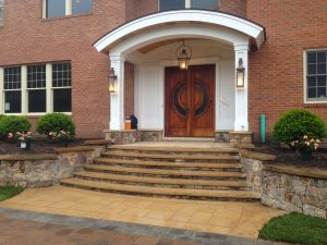 front entry with new portico and steps to doorway