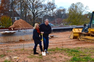 clients break ground at custom home site