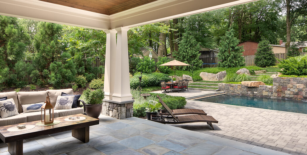 full shade structure and hedgerow provide poolside shade