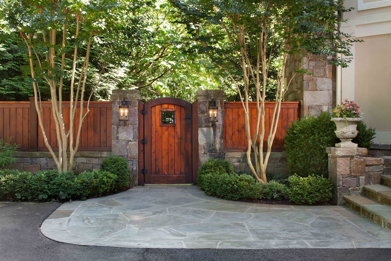 redwood garden gate and flag stone patio