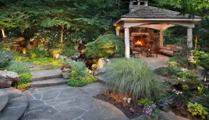landscape maintenance around outdoor fireplace and pavilion
