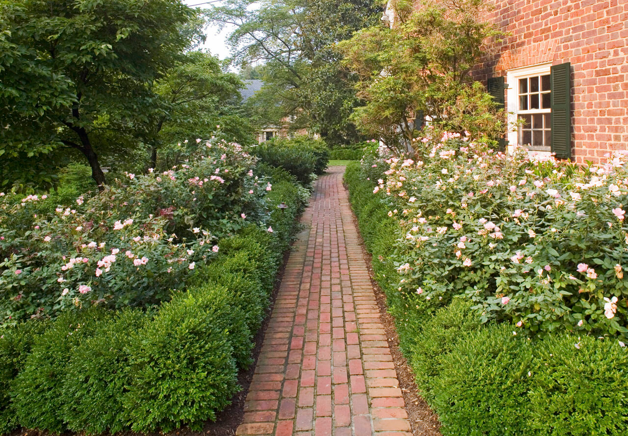 permeable brick walkway with natural border plantings