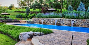 pool with water-spouts built into retaining-wall