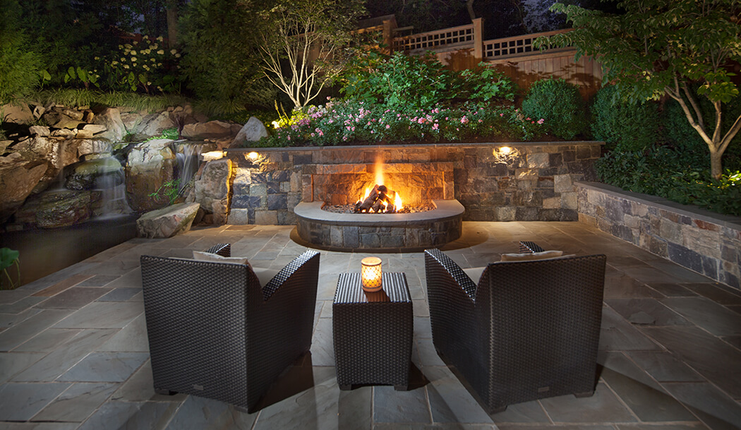 small yard firepit built into retaining wall