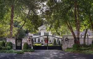 front yard privacy with see through ornamental gates and curb plantings