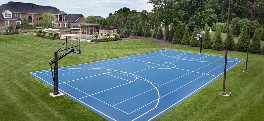backyard swimming pool and sports court