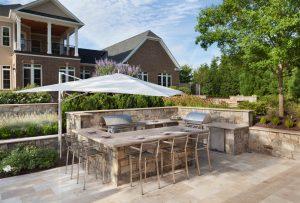 deluxe outdoor kitchen near pool deck