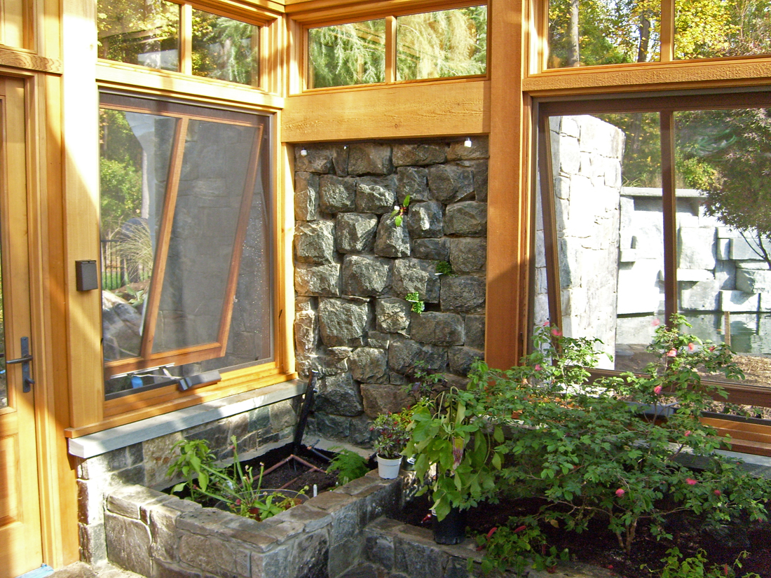 greenhouse-interior-stone-wall-integration