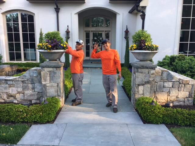 landscape management crewmen on job site