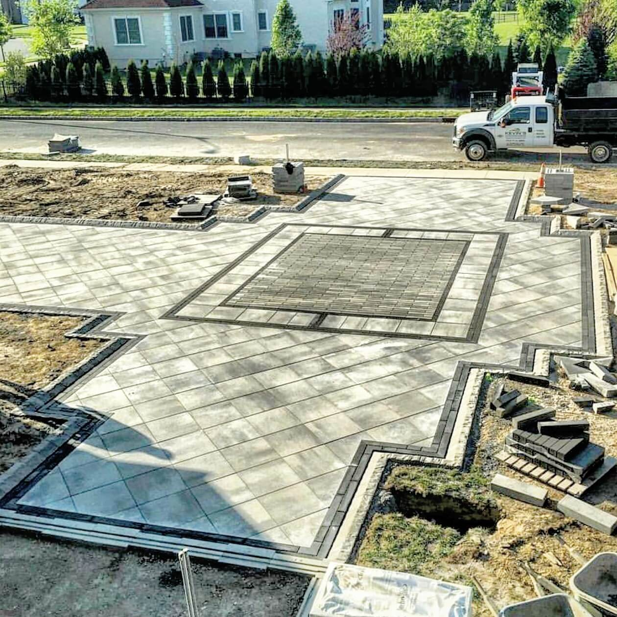 paver driveway with ornate inlay and border design
