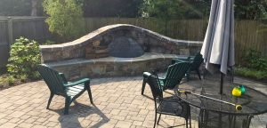 stone fire pit and paver patio