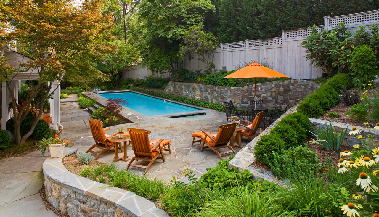terraced planting beds and pool patio