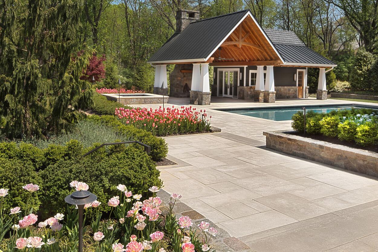 Oakton pool house and pool deck border bedding plants