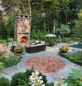 fireplace and sitting patio adjacent to spa