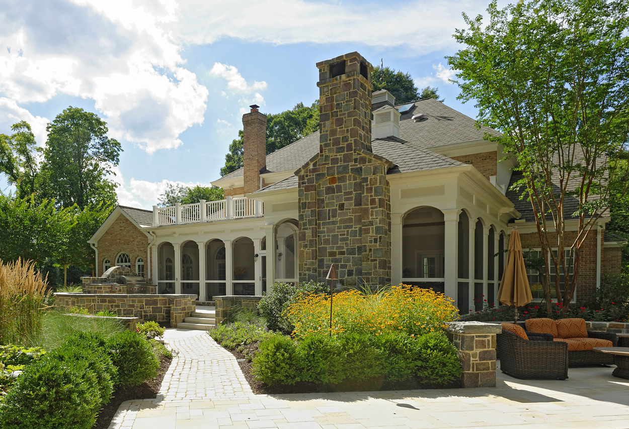 porch design with stone chimney